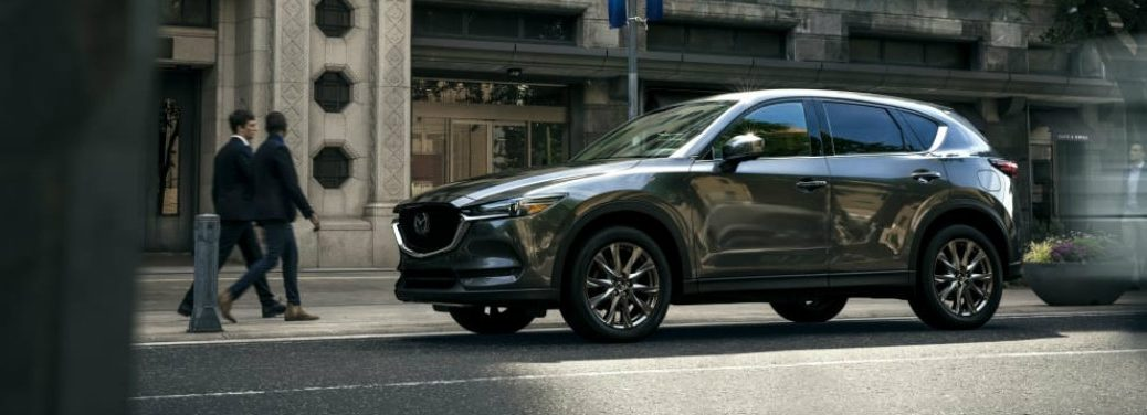 left side view of dark silver mazda cx-5 on city street