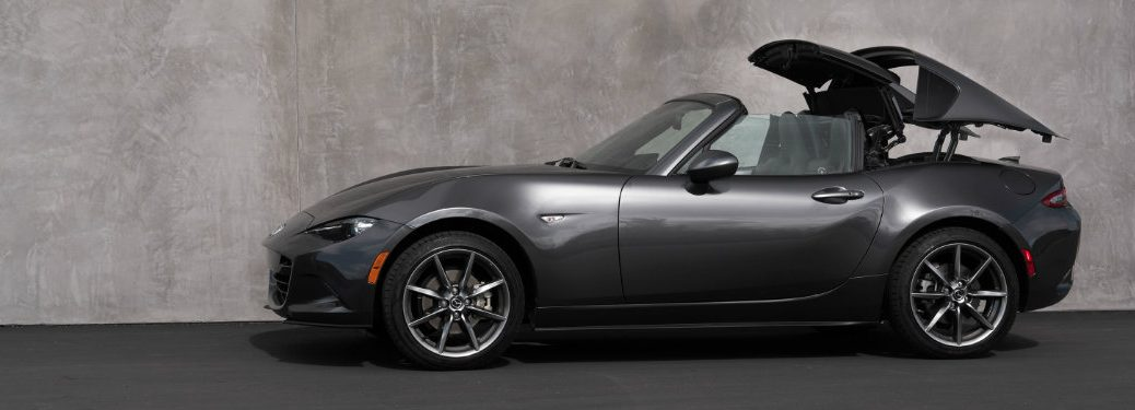 left side view of dark gray mazda mx-5 miata rf