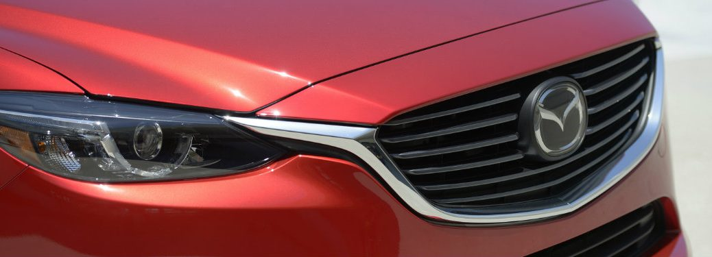 mazda logo and grille of red mazda cx-3