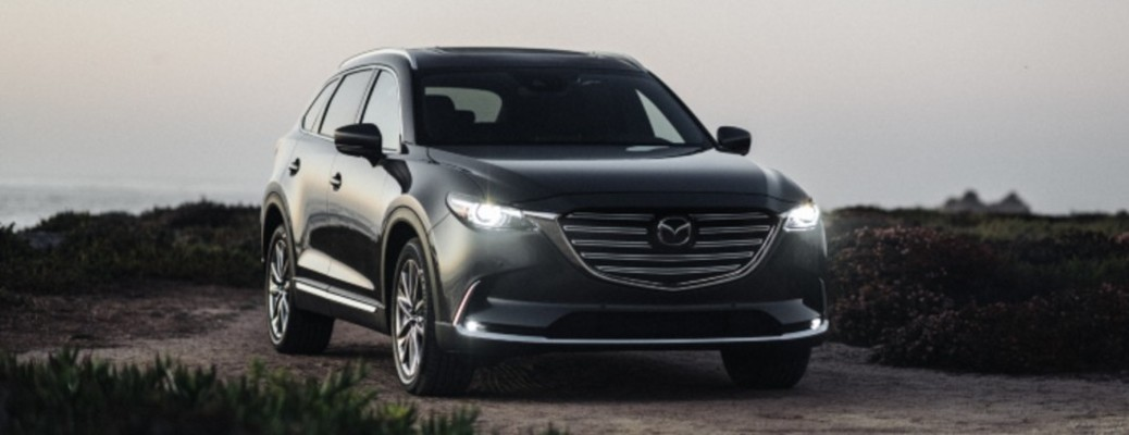 The front exterior of a black 2020 Mazda CX-9.