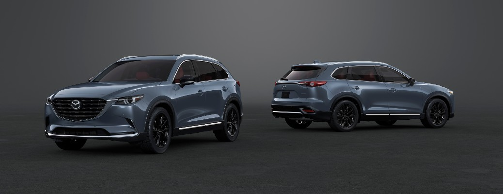 The side and rear view of a gray 2021 Mazda CX-9 Carbon Edition.