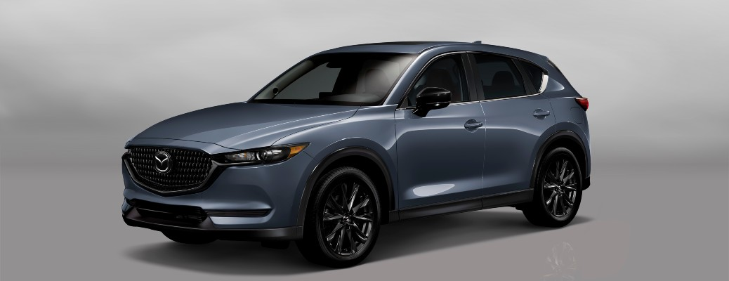 The front and side view of a grey 2021 Mazda CX-5 Carbon Edition.