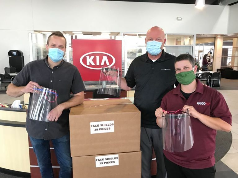staff at peak kia donating masks