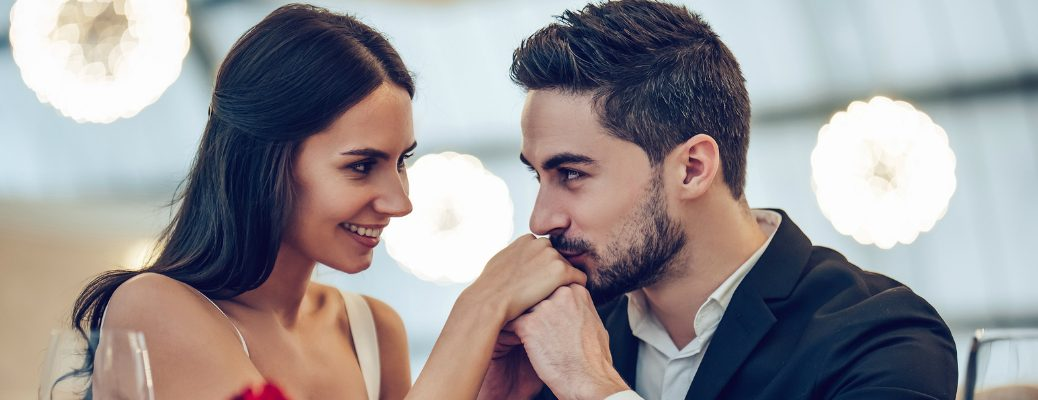 Man Kissing His Girlfriend's Hands During Dunner
