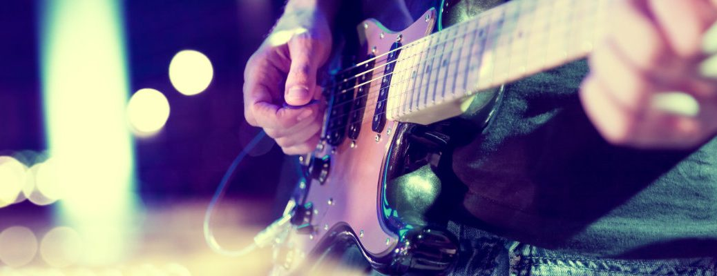 Stylized image of guitar player performing on stage