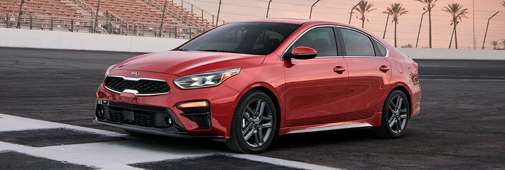 2019 Kia Forte red on a sportway looking fast