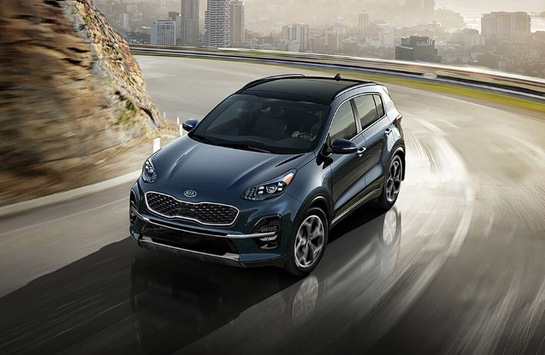 Exterior view of the front of a blue 2020 Kia Sportage