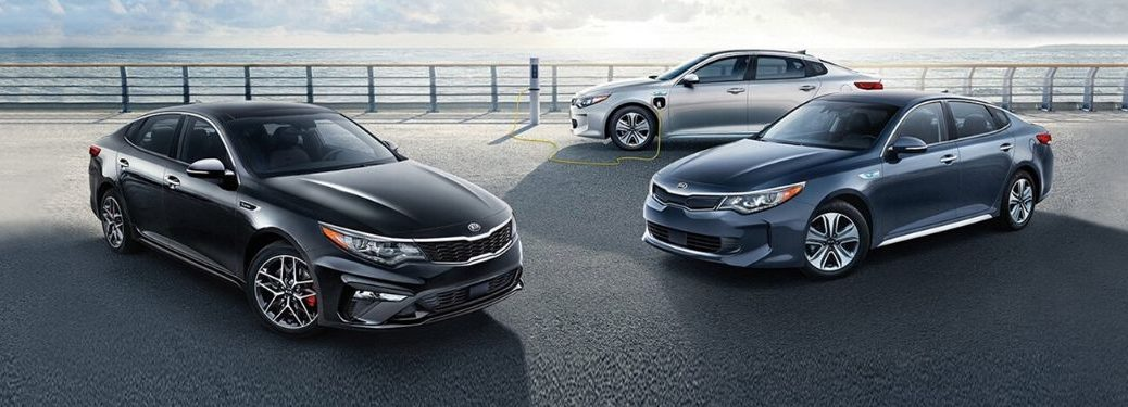 Exterior view of three 2020 Kia Optima models