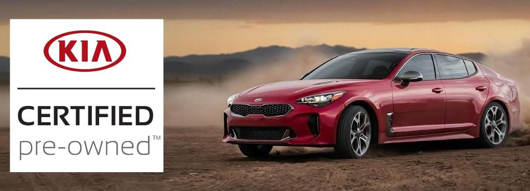 Kia Certified Pre-Owned logo with a red 2020 Kia Stinger