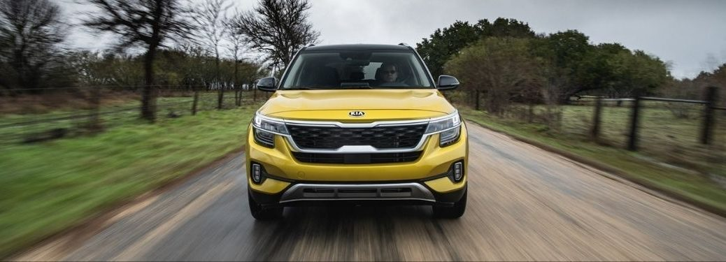 Exterior view of the front of a yellow 2021 Kia Seltos