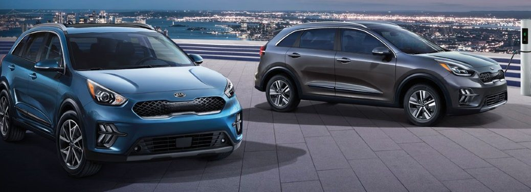 Two 2020 Kia Niro crossovers parked next to each other