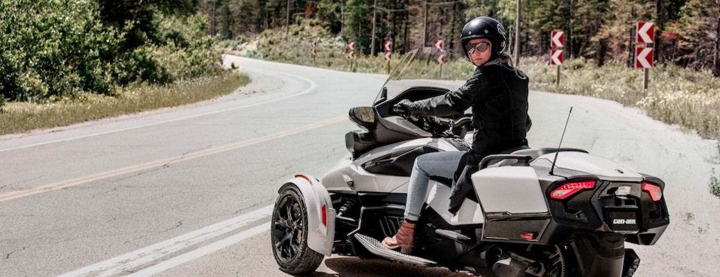 A woman looking for traffic while sitting on a 2020 Can-Am Spyder.