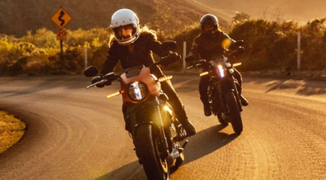 Two motorcycle riders on Livewire® motorcycles on an open rural road.