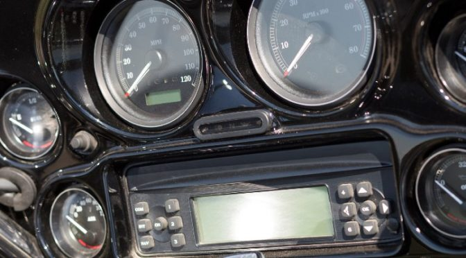 A closeup image of a motorcycle stereo with dials and buttons.