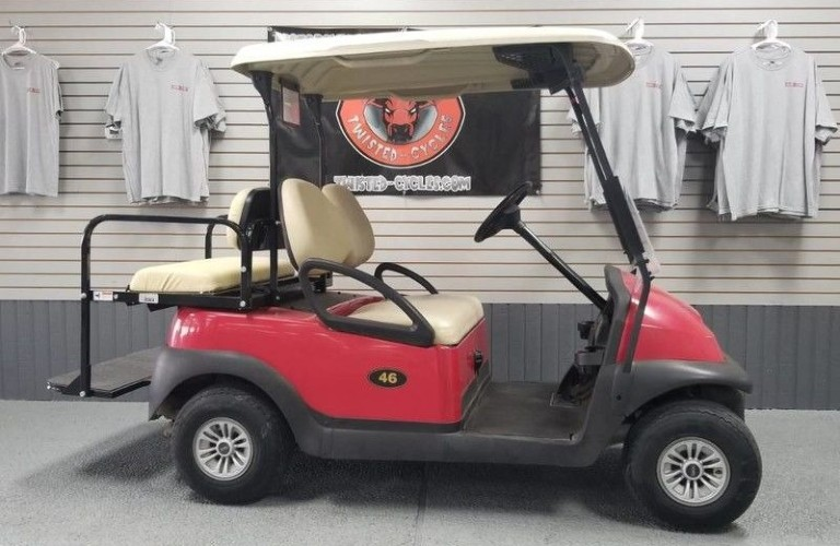 A red golf cart that can be foudn at Twisted Cycles in Lubbock, TX.