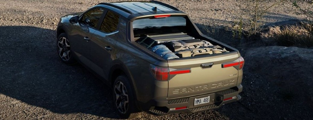 A 2022 Hyundai Santa Cruz parked outside with the bed of the truck filled with cargo items