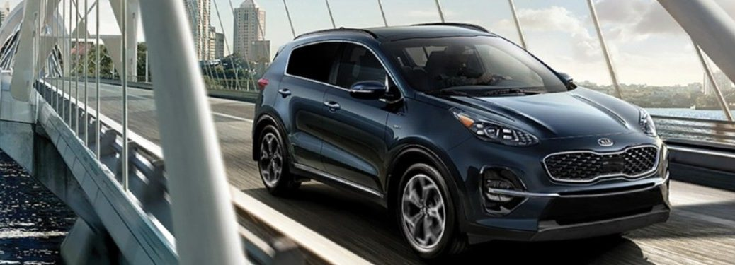2021 Kia Sportage blue exterior driving on bridge