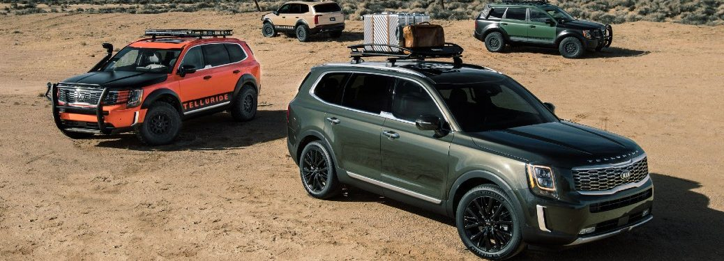 four 2021 kia tellurides parked in desert area