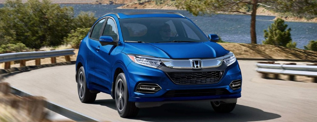 Front view of blue 2020 Honda HR-V on twisting road by the sea