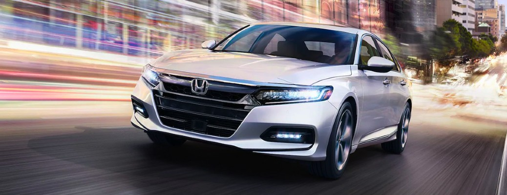 2020 Honda Accord Touring white exterior front driver side driving in city