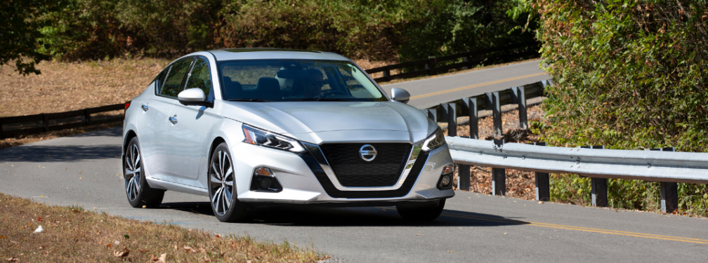 Silver 2020 Nissan Altima Driving on a Country Road