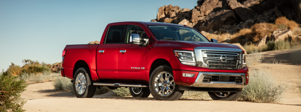 Front view of red 2020 Nissan TITAN Platinum Reserve on off-road terrain