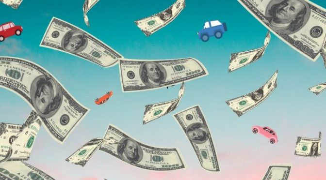 A bevy of money rains down in the sky amidst various cars