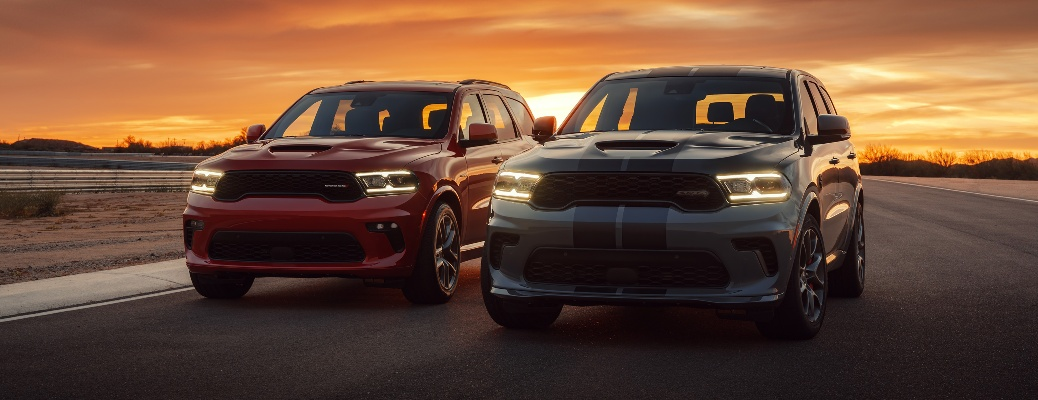 Two 2021 Dodge Durango vehicles going down the road