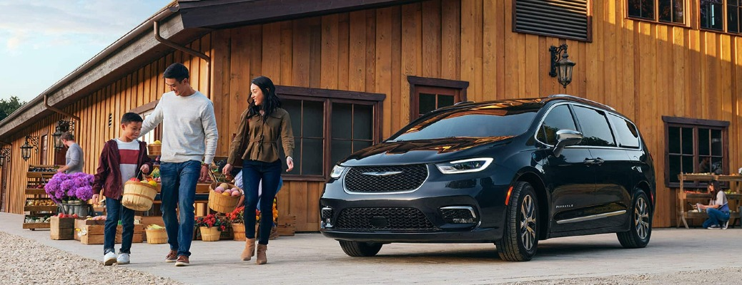 2021 Chrysler Pacifica Hybrid with its family outside of a store