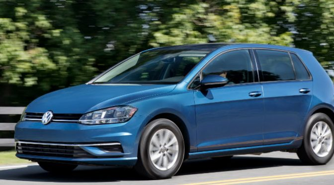 2018 Volkswagen Golf R driving down a forested road