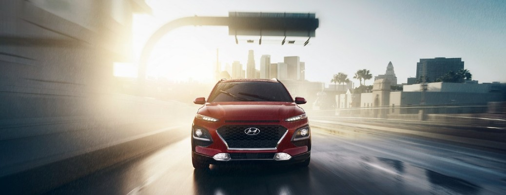 2020 Hyundai Kona Red driving on wet road toward shot