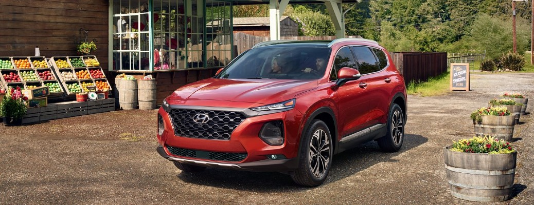 2020 Hyundai Santa Fe red parked on dirt at farmers market