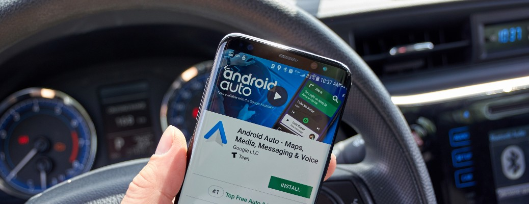 phone on with android auto app active on screen
