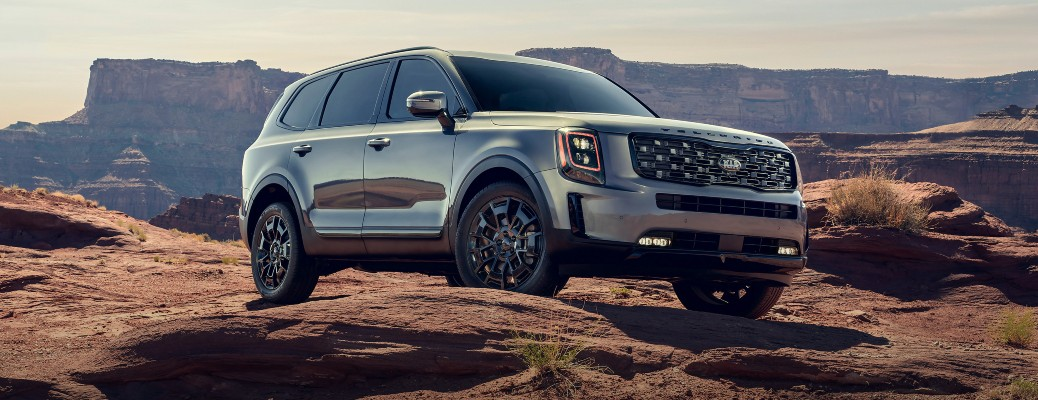 2021 Kia Telluride parked on rocks in front of canyon