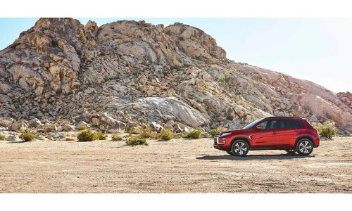 2020 Mitsubishi RVR on right side of shot with rock formation