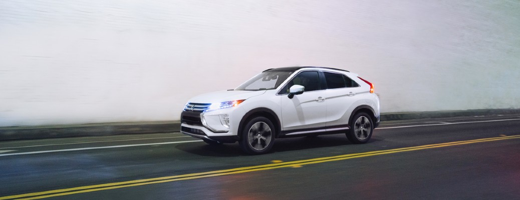2020 Mitsubishi Eclipse Cross white driving down road inside tunnel