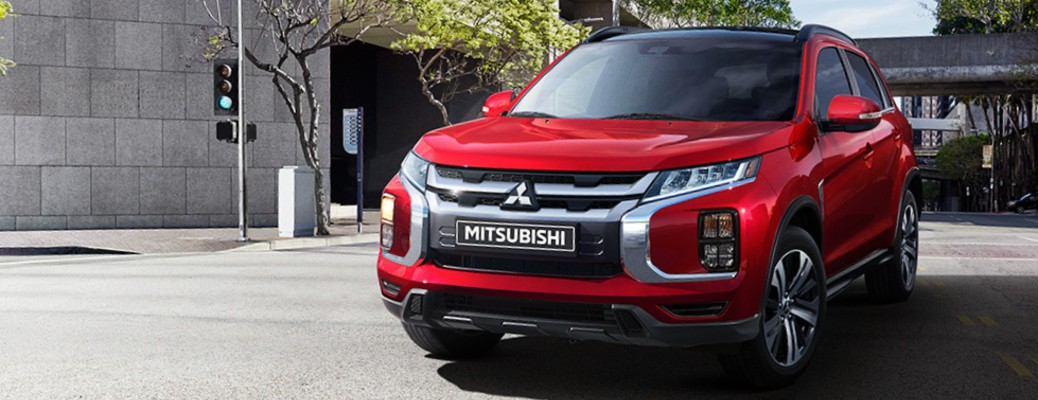 2021 Mitsubishi RVR red driving through intersection