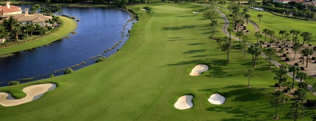An aerial photograph of a golf course by a river