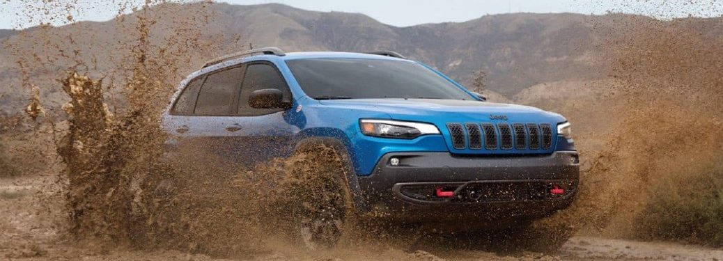 2021 Jeep Cherokee driving on a muddy road