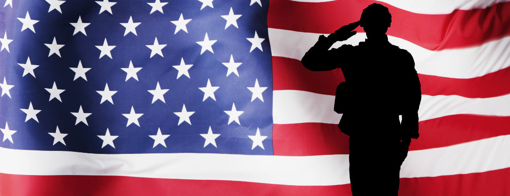 Silhouette of soldier in front of American flag