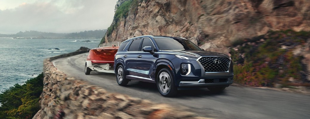 Blue 2021 Hyundai Palisade towing boat