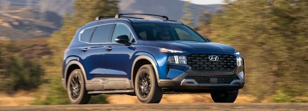 Blue 2022 Hyundai Santa Fe XRT Front and Side on Dirt Road