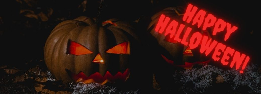 Lit Halloween Jack-o-Lanterns with Glowing Red Happy Halloween Text