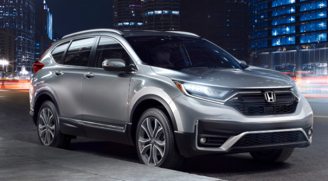 Front view of 2020 Honda CR-V Touring in Lunar Silver Metallic parked on the street with headlights on