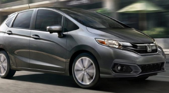 2020 Honda Fit grey exterior front passenger side driving in city