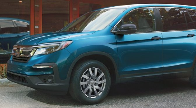 2020 Honda Pilot LX aqua exterior front driver side parked in front of wood house