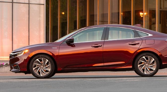 2020 Honda Insight red exterior driver side parked outside of nice building