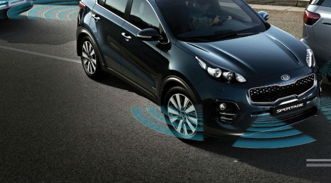 2018 Kia Sportage Named Best New SUV for Teens with image of a Sportage with Parking Assist feature