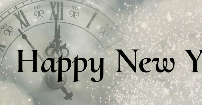 Happy New Year in text with clock and white lights in background