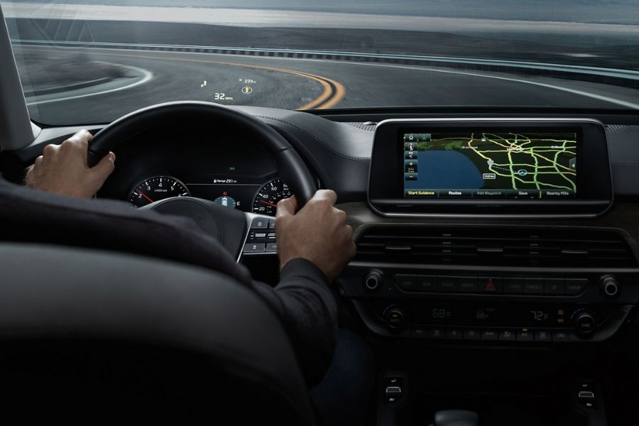 2020 Kia Telluride interior from behind driver's shoulder showing navigation and Head-Up Display
